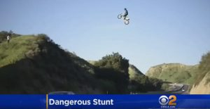 YOLO : Dirtbike Rider Gets in Trouble Road Jump